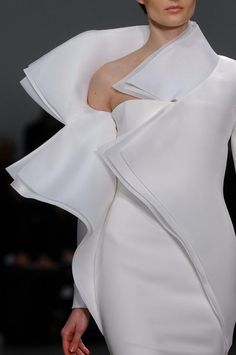 Stephane Rolland...I couldnt wear this anywhere, but I would sure love to work it on the runway