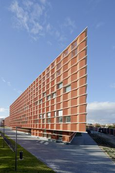 Terracotta panels create zigzagging walls for Madrid university building by Estudio Beldarrain.