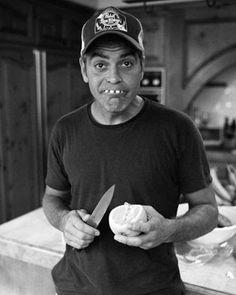George Clooney eating an orange