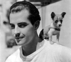 0 Ramon Novarro and puppy Chiquita on his shoulder