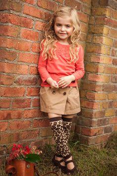 Little girl wearing BabyLegs Laughing Leopard legwarmers.