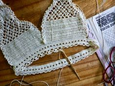 """""""Touché Temptair"""" is a pair of crocheted underwear that sits at the hips and ties with a string. It starts at the waist, in the round, ..."""