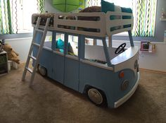 Custom made VW Bus bunk bed. Beds are twin mattresses. The bed is made from wood. It has real VW hubcaps and working lights. It also has a bench seat in the bottom bed and a steering wheel.