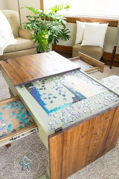 Puzzle coffee table. Found on Facebook. https://www.facebook.com/designeddecor/photos/a.220771671347702.52870.181786408579562/1615664615191727/?type=3