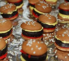 """birthday treat """"hamburgers"""" : vanilla wafters, peppermint patty, tinted icing, and sesame seeds :)"""