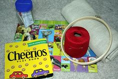 Activity Bag #4    The Cheerios Play Book  Another $1 Target jigsaw puzzle  Credit card mailbox  Embroidery hoop  Burlap  Crochet thread  Large dull needle (darning needles work great)