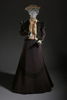 Woman's Two-Piece Dress, circa 1900  Costume/clothing principle attire/lower body; Costume/clothing principle attire/upper body, Ribbed silk jacket and skirt with velvet and lace trim; silk georgette dickey with shell embroidery, lace, and satin trim,