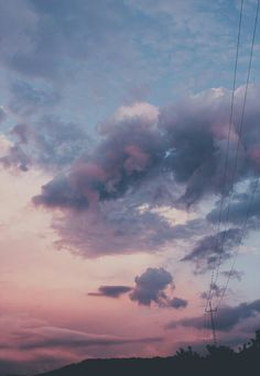 Blue pink skys. Dark clouds. electricity lines. nature plus urban