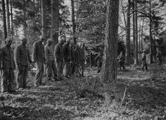 Ww2 • Prisoners from Buchenwald awaiting execution in the forest near the camp..the more i see, the more it breaks my heart...look at the complacency of one of the SS men in the background...hands behind his back...perhaps talking about the beauty of the surroundings?