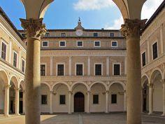 Urbino - Ducal Palace - Interior Courtyard.  Designed by Luciano Laurana (c.1420-78).  Begun c.1468.  Ducal Palace, Urbino, Italy.