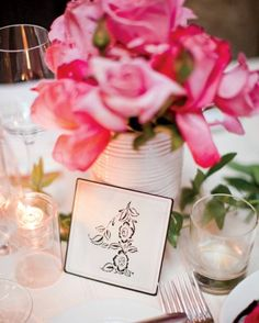 Floral Table Card  A romantic floral design made the numbers that marked each table at this wedding.