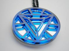 Sale 30% - Iron Man Necklace -Heart Arc Reactor -  Laser Cut Transparent Blue  Acrylic  and Mirror Plastic. $13.95, via Etsy.