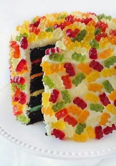 Love candy decorated cakes. Pinning for the different interior colored frostings.