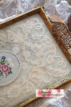 You could use an old frame to put a vintage lace inside. Then add handles to create a lovely tray.