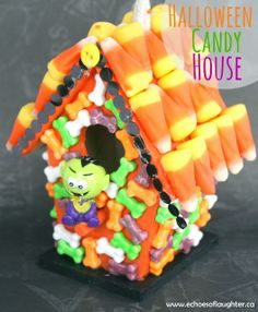 Cute Halloween Candy House-a really cute craft to make with kids! Start with an unpainted birdhouse and paint it and glue on candy!