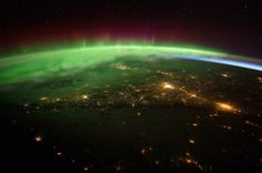International Space Station — The crew aboard the International Space Station captures a spectacular image of an aurora borealis as the spacecraft passes over a section of western Canada.    PHOTOGRAPH BY: NASA