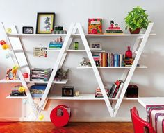 2 step ladders placed upside down and bolted to the wall & layer boards slid in to make uneven shelving, thus creating a amazing shelving system