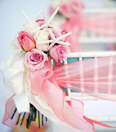 Chair decor made of roses, finger starfish and ribbon.