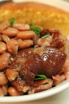 Southern Style Pinto Beans with Fork Tender Ham Hocks, made in the Crock Pot! Serve these beans over rice and along with corn bread, and you have a winner!