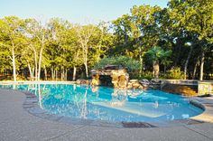 Your backyard should be a retreat. This gently curved pool and spa has plenty of privacy from the neighbors and the pool's cave will make you feel like you're at a resort. www.seanknightcustomhomes.com