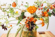 late summer floral arrangement that includes tomatoes !