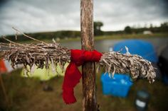 A sage tie, which has spiritual significance for Native American Plains tribes, hangs at the Seven Council camp, one of three encampments that have grown on the banks of the Cannon Ball River. REUTERS/Andrew Cullen