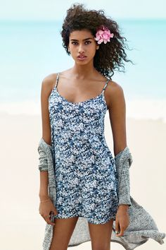 A breezy blue patterned dress and lightweight cardigan are perfect for beach days. | H&M Divided