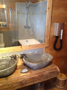 Completed chalet bathroom at ChaletLeMoulin.co.uk - stone sinks from tikamoon, LED taps Amazon, river stones...