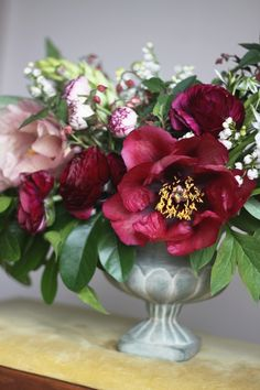 To enjoy the blooms of Herbaceous Peonies later in the summer, cut the buds just before they open on stems about 6 inches long. Lightly wet the inside of a large, resealable plastic bag, and place the buds inside. Close the bag and place it in your refrigerator (not the freezer). Later take out the buds you need and float them in a shallow bowl of water. When bud is about 1/3 open, lift it, then cut the stem to 1 1/2 inches long and refloat the bud.
