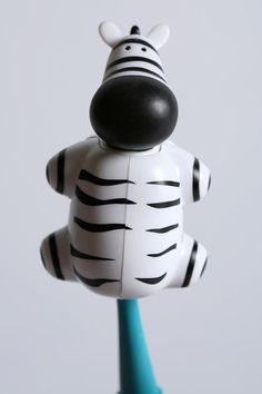 I want the most pointless and ridiculous things in life... Like this zebra toothbrush holder.