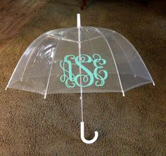 Monogram Umbrella...for some reason, I really want one of these... I want one so my hair doesn't frizz in the rain, and it's monogrammed.