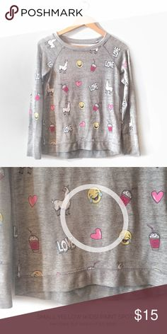 Justice Girls Emoji Graphic Sweatshirt Justice Girls Gray Graphic Sweatshirt.   Emoji print / Graphic all over front and back.  Size: 12 (large)  Good condition. A little wash & wear visible and there is some very small spots of yellow paint on front. Not very noticeable with all the Graphic. Justice Shirts & Tops Sweatshirts & Hoodies