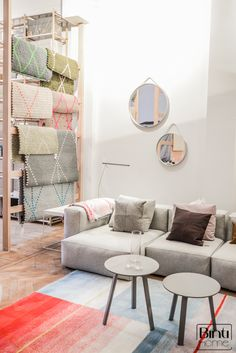 Hay store Amsterdam, mirrors on the wall and carpets display, Binti Home Blog