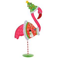 """We've taken kitsch to new heights with our Ugly Sweater-wearing Pink Flamingo! Our metal figure stands 15"""" tall and comes with a set of magnets that lets you dress him in an ugly Christmas sweater."""