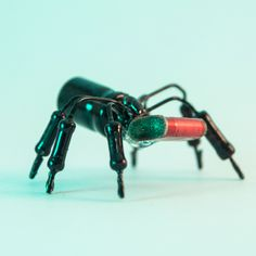 It would be a spider if it had more legs. Now it's just a component bug. Materials sourced from an old stereo system and soldered together. Black gloss finish.