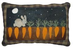 HA! this is what the rabbits do to my garden. wool rabbit penny rug pillow