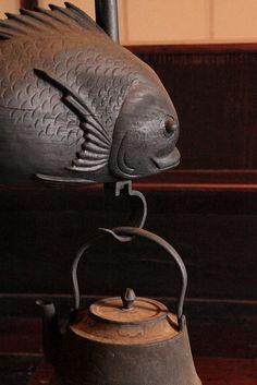 Jizaikagi (fish hook) holding a tetsubin (iron kettle), I love this jizai kagi. These were used in traditional farm houses over the irori (hearth on the floor) to heat water for ocha (tea)