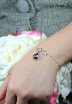 Purple wedding jewelry Infinity bracelet Awwww... I love this! Especially if you get married on Pi Day - have an infinity bracelet!! (Math nerd here, sorry!)