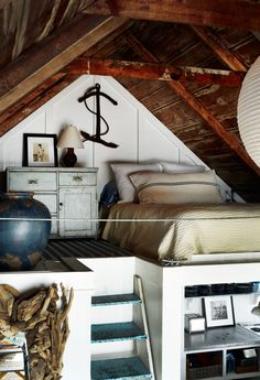 have you ever seen a more perfect beach home? - small seaside cottage bedroom loft // captain jack's wharf Even if it's a small home like this, I WILL have a beach house one day. Attic Bedrooms, Bedroom Loft, Attic Loft, Garage Attic, Bedroom Beach, Attic Ladder, Attic Playroom, Raised Bedroom, Attic House