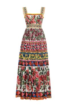 This maxi by **Dolce & Gabbana** is printed with the brand's signature floral mosaic print at each tier and a floor length pleated skirt.