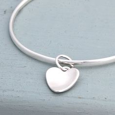 flutter handmade silver heart bangle by alison moore silver designs | notonthehighstreet.com