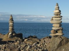 I don't know where this particular photo originated from but when you drive along White River in Ontario Canada, you will see stacks of rocks every where along the side of the road. I don't know who made them but they go on for miles and miles.  They sell T-shirts with stacks of rocks on them. :-)