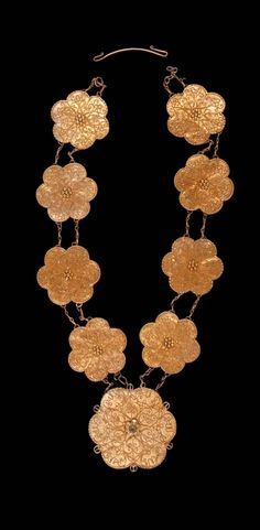 Indonesia - Sulawesi Islands, Wadjo | Necklace ~ Génong lampe ~ from the Bugi people.  Part of a bridal costume //  ©Quai Branly Museum. 71.1969.19.177.1-10
