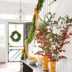 Christmas Decorations: Using Natural Materials. Ensure your home is decked out with color and organic touches. Ideas for stairwells, mantels & more. #Christmas #decor #ideas