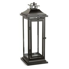 Light up your event with this tall metal lantern. The sides have glass inserts for maximum light reflection. Lantern measures 17 inches tall by 6 inches wide. Place your favorite candle inside, or use
