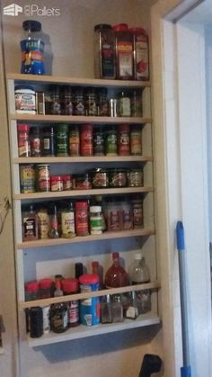 We needed some storage space while adding visibility, so I made this Hanging Pallet Spice Rack for our pantry cupboard. It only took a couple of hours, and was very easy! Hanging Pallet Spice Rack: This is a spice rack made out of eight Pallet Pantry, Wooden Pallet Shelves, Wooden Pallets, Wooden Diy, Pallet Spice Rack, Spice Racks, Latest Pallet Ideas, 1001 Palettes, Decoration Palette