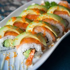 Sunshine Roll: Salmon tempura and avocado inside, topped with salmon, spicy mayonnaise & tempura crunch