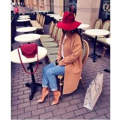 Camel coat, red hat and bag, with tshirt and jeans. Stylish Saturday afternoon in the Fall.