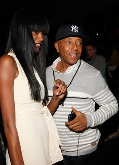 Jessica White and Russell Simmons attend the Charlotte Ronson Fall 2012 fashion show during Mercedes-Benz Fashion Week at The Stage at Lincoln Center