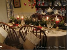 I like this rustic Christmas table - makes good use of those tree-trimmings I usually get from Home Depot every year!  Found on: Confessions of a Plate Addict